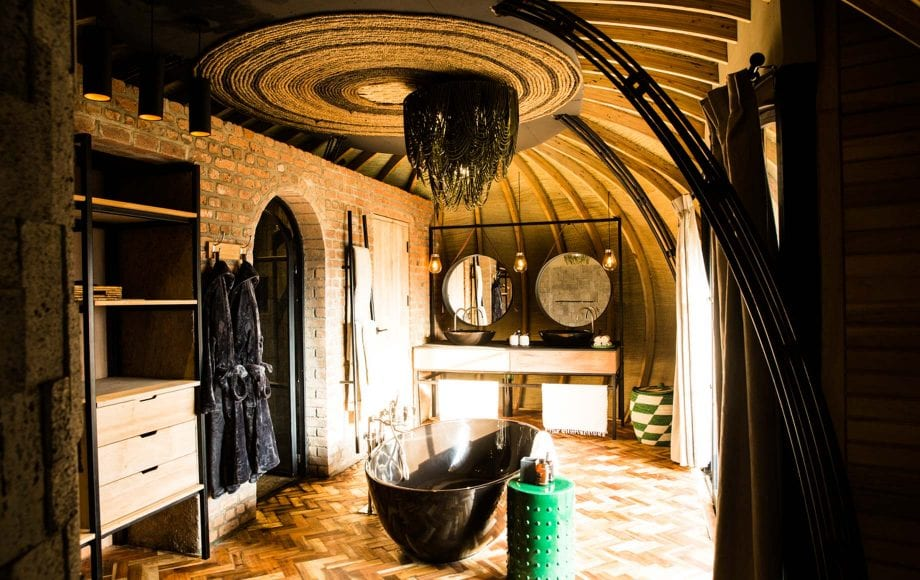 Bright bathroom with Bathtub at Bisate Lodge in Africa